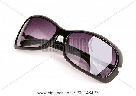 Sunglasses female glasses isolated on white background macro .