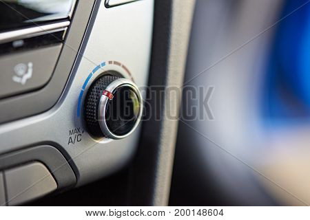 Macro of air conditioner  knob in modern car interior