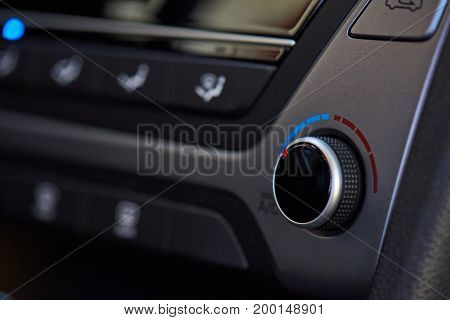 Modern car climate dashboard close-up. Service of air conditioner