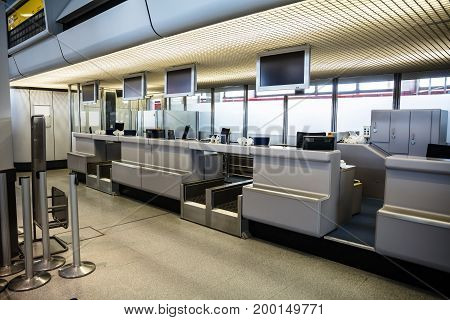 Checkin area with monitors mounted on ceiling at modern airport