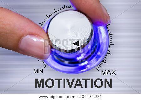 Close-up Of A Human Hand Adjusting Motivation Knob