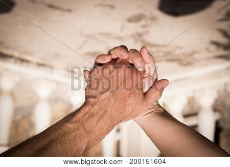 Hands of two lovers intertwined. Tranquil scene