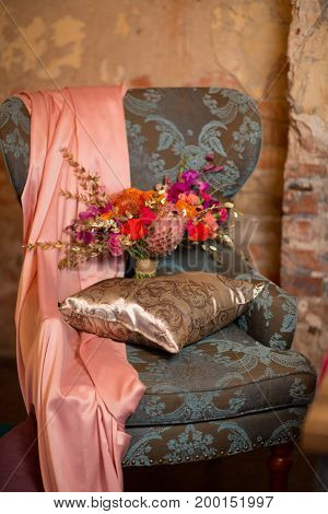 Armchair with flowers, decorate in purple, pink and orange