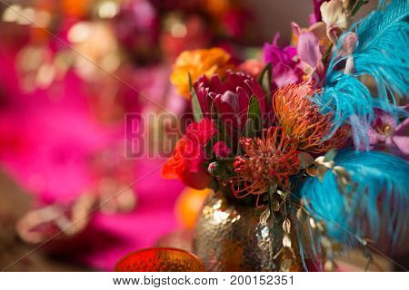 table set with flowers in a vase in a pink and purple background
