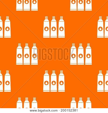Three tubes with paint pattern repeat seamless in orange color for any design. Vector geometric illustration