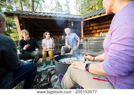 Business People Talking While Having Lunch In Forest