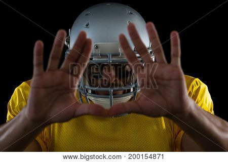 Portrait of American football player showing hand gestures