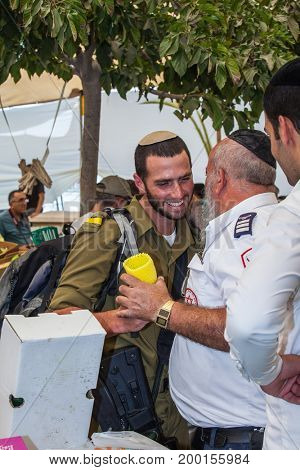 JERUSALEM, ISRAEL - OCTOBER 8, 2014: Sukkot in Israel. Traditional festive market in Jerusalem. Jews buy four ritual plants