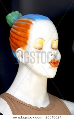 Female Mannequin Blowing A Kiss