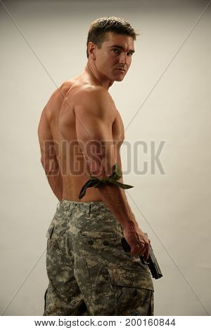 The sultry photo is of an army man.