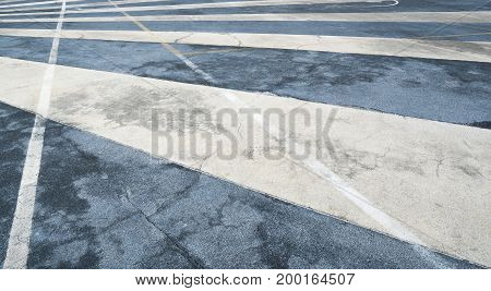 Close up asphalt road surface with white traffic strip