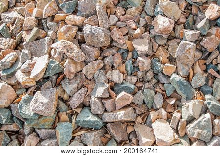 Crushed stones used for landscaping in a close-up view.