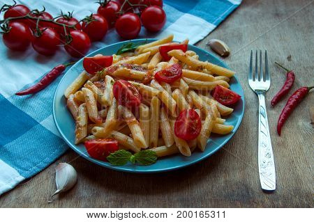 Pasta Penne With Tomatoes And Pepper Chilli