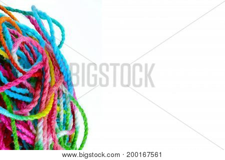 tangled yarn tangled colorful sewing threads on white background with copy space.