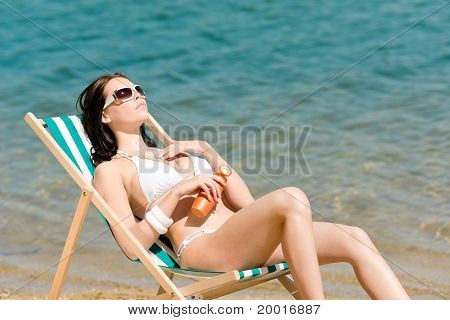 Summer Young Woman Sunbathing In Bikini Suncream