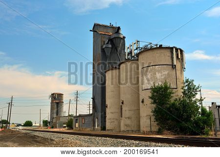 Cell Tower on an Old Antique Agricultural Grain Elevator Silo with Railroad Tracks