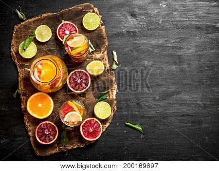 Citrus Background. Fresh Citrus Juice With Slices Of Limes, Oranges, Grapefruits And Lemons.