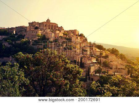 Gordes medieval village at sunrise in Provence, France