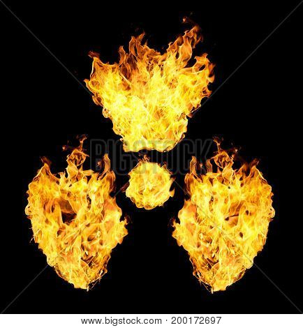 Nuclear symbol from fire flames isolated on black background.
