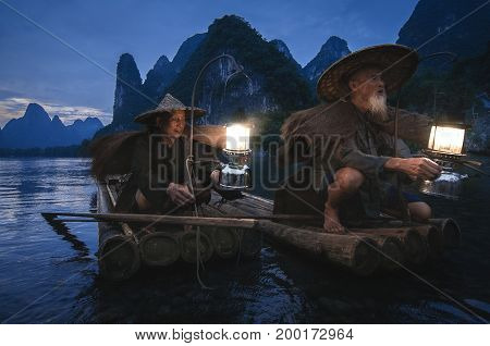 Guilin China; 17th June 2014 - Guilin's cormorant fishermen setting up their lantern for preparation for night fishing.