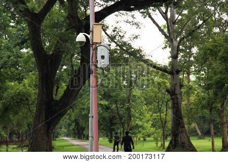CCTV in a park overlooking people and historical site