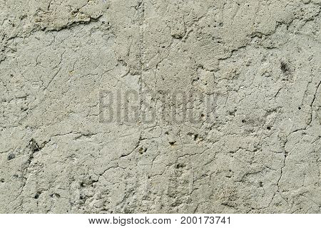 Old grunge cracked concrete wall texture background