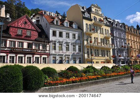 Carlsbad, Czech Republic - September 2014: Beautifully restored historic houses in old part of Carlsbad, in September 2014, with people on the street