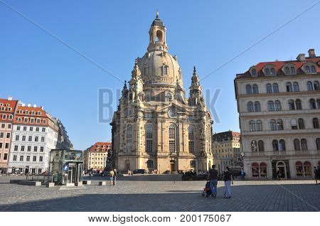 Dresden, Germany - September 2014: Frauenkirche in Dresden, Germany in September 2014, with people on the street and the public square in front