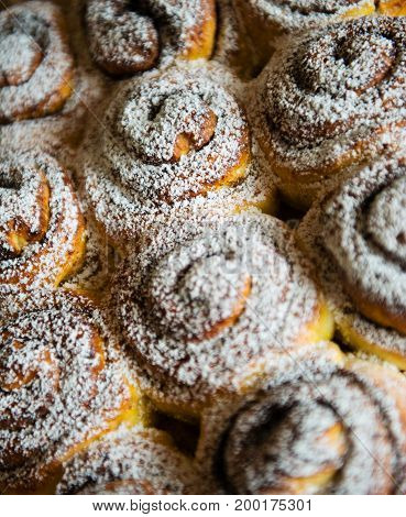 Sweet buns with sugar background. Small DOF