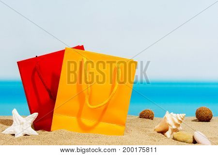 Summer signings bags on the beach and sea