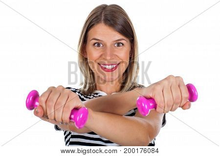 Picture of a smiling young woman holding pink dumbbells posing on isolated background