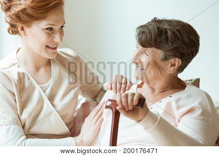 Elder Holding Walking Stick