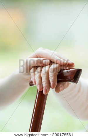 Caregiver's Hand On Elder's Hand
