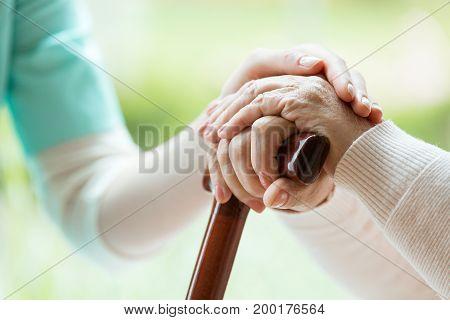 Nurse Comforting Elder Lady