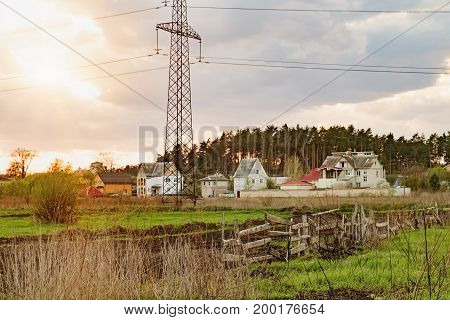 View of rural Ukrainian landscape in autumn. Countryside farm and fields village pine forest on the horizon and dramatic sunset sky in Irpin Ukraine.