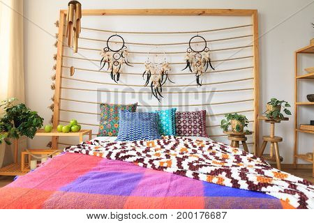 Bed With Ethnic Decorations