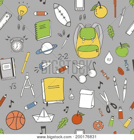 Seamless pattern with hand drawn school items.