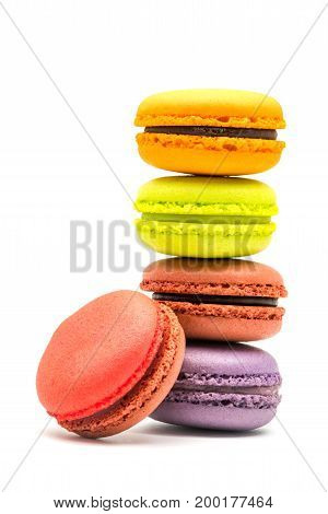 Tower of sweet macarons on white background
