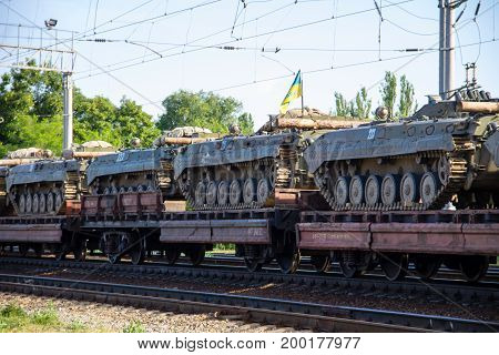 Cargo Train Carrying Military Tanks On Railway Flat Wagons