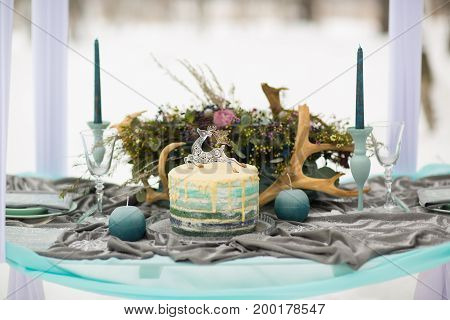 decorate Wedding Cake with beautiful winter flowers and candles