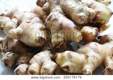 Fresh, Raw Ginger root on white isolated background