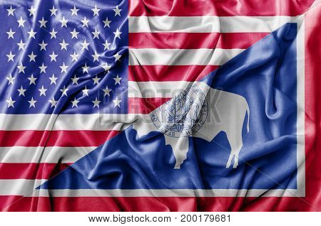 Ruffled waving United States of America and Wyoming flag