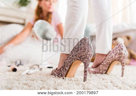 Girl In Mothers High Heels