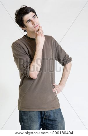 Thinking young man on a white background