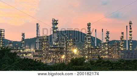 Petrochemical plant at twilight,Glow light of petrochemical industry on sunset and Twilight sky ,Power plant,Energy power station area