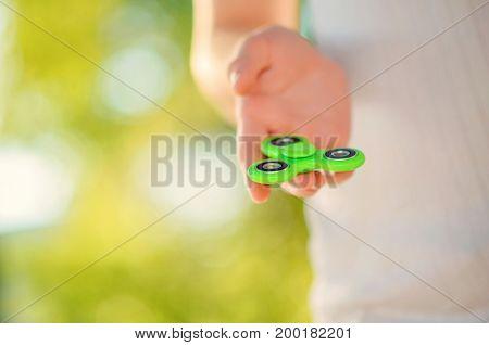 Teenager On The White T-shirt  Hand Holding Antistress Fidget Spinner