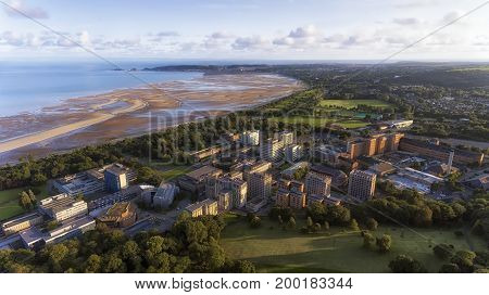 Editorial SWANSEA, UK - AUG 15, 2017: Swansea West, looking towards The Mumbles from Singleton Park, showing the university, Singleton hospital and the bay.