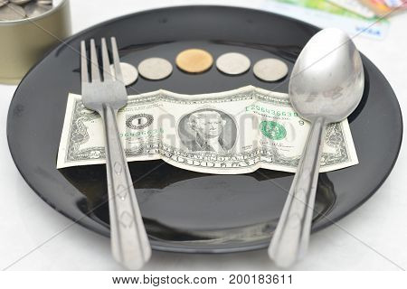 Money in a plate Money canned and Credit card.