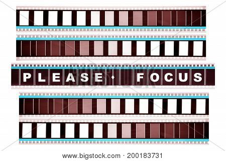 Piece of 35 mm motion film with the word 'please focus' on it