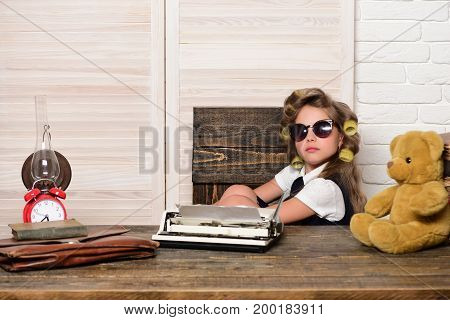 Child with briefcase and alarm clock. Kid choose career in glasses. Small girl with curler in hair. Education and childhood. Little baby secretary.